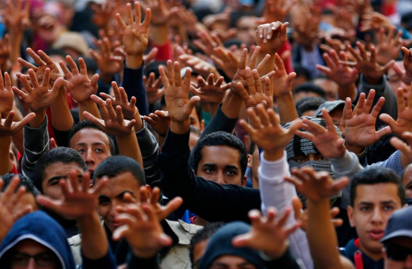 Cairo University students shout slogans against the government after the verdict of former Egyptian President Hosni Mubarak's trial (photo credit: REUTERS)