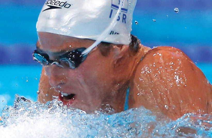 Israeli swimmer Amit Ivry reached the semifinals of the 50-meter breaststroke at the world short course swimming championships last night in Doha, Qatar, but came up short in her attempt to qualify for the final. (photo credit: REUTERS)