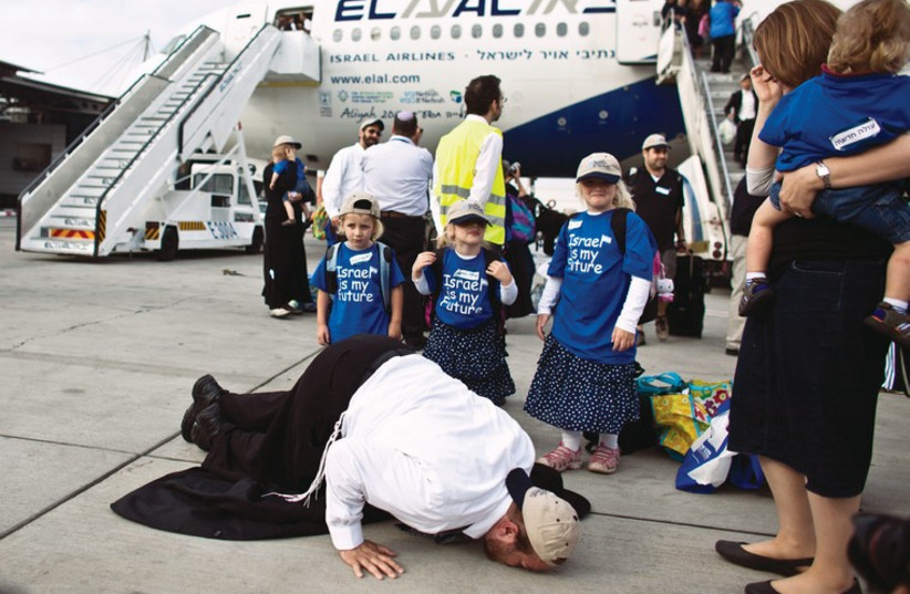 A new immigrant at Ben-Gurion airport kisses the tarmac as he makes aliya (photo credit: REUTERS)