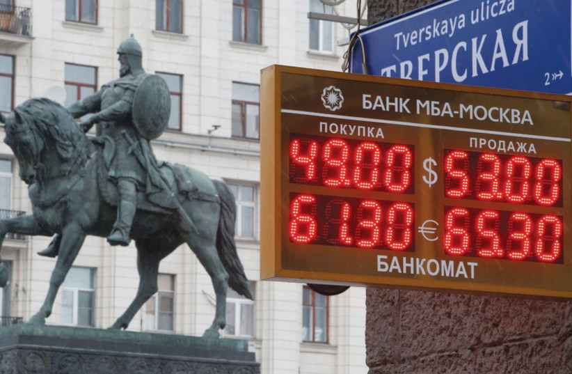 A BOARD showing currency exchange rates in Moscow on Monday, when oil prices fell to their lowest in five years. Russia's ruble dropped more than 4 percent against the dollar while Malaysia's ringgit, also oil-dependent, was on course for its biggest two-day fall since the 1997-8 Asian financial cri (photo credit: REUTERS)