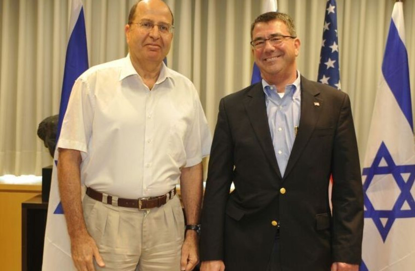 Defense Minister Moshe Ya'alon (L) and the man picked to head the Pentagon, Ashton Carter, meet in Jerusalem (photo credit: ARIEL HERMONI / DEFENSE MINISTRY)