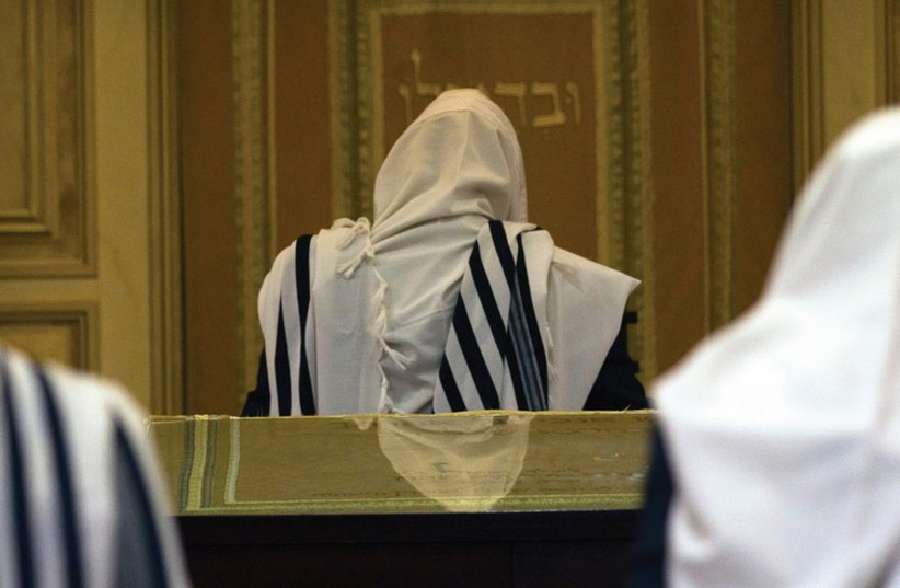 WORSHIPERS GATHER at the Har Nof synagogue that was the site of a brutal terror attack (photo credit: REUTERS)