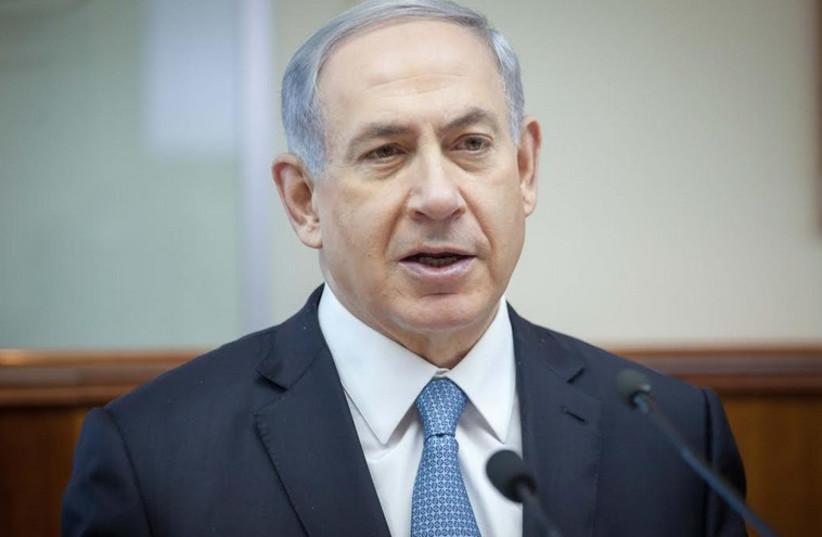 Prime Minister Benjamin Netanyahu addresses the weekly cabinet meeting in Jerusalem, December 7, 2014. (photo credit: EMIL SALMAN/POOL)