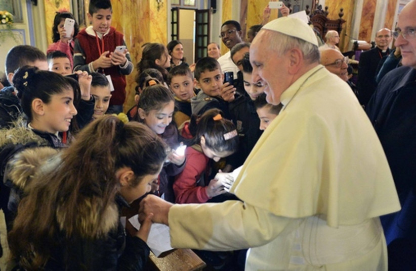 Pope Francis greets Christian children in the Middle East (photo credit: REUTERS)