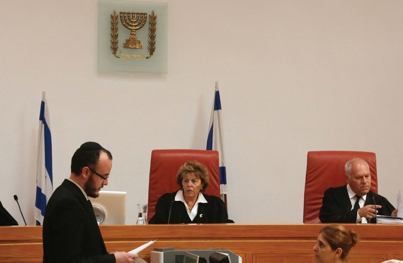 ISRAEL SUPREME Court justices at a hearing. The court has invalidated the infiltrators law. (photo credit: MARC ISRAEL SELLEM/THE JERUSALEM POST)