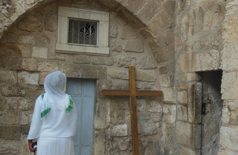 A Christian woman outside the Church of the Holy Sepulchre in Jerusalem (photo credit: ARIEL COHEN)