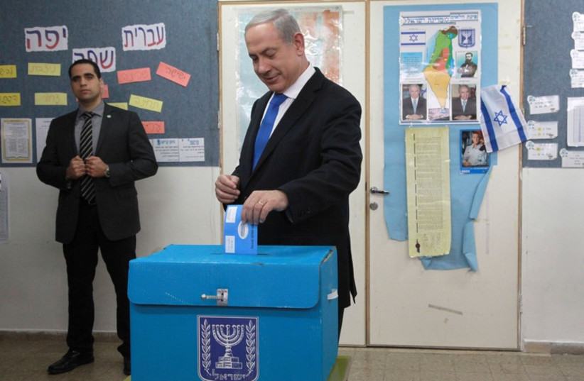 Prime Minister Benjamin Netanyahu casts his ballot in the 2013 election[File] (photo credit: MARC ISRAEL SELLEM/THE JERUSALEM POST)