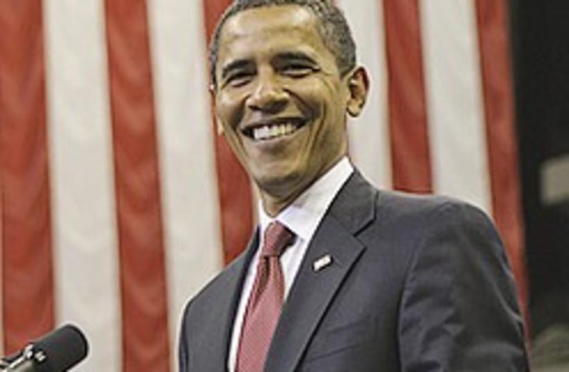 obama smiles 224.88 (photo credit: AP)