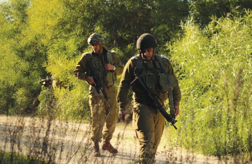 An IDF Beduin tracker on patrol. Unlike other minorities that serve in the army, for Beduin, service is on a volunteer basis. (photo credit: IDF SPOKESMAN'S UNIT)