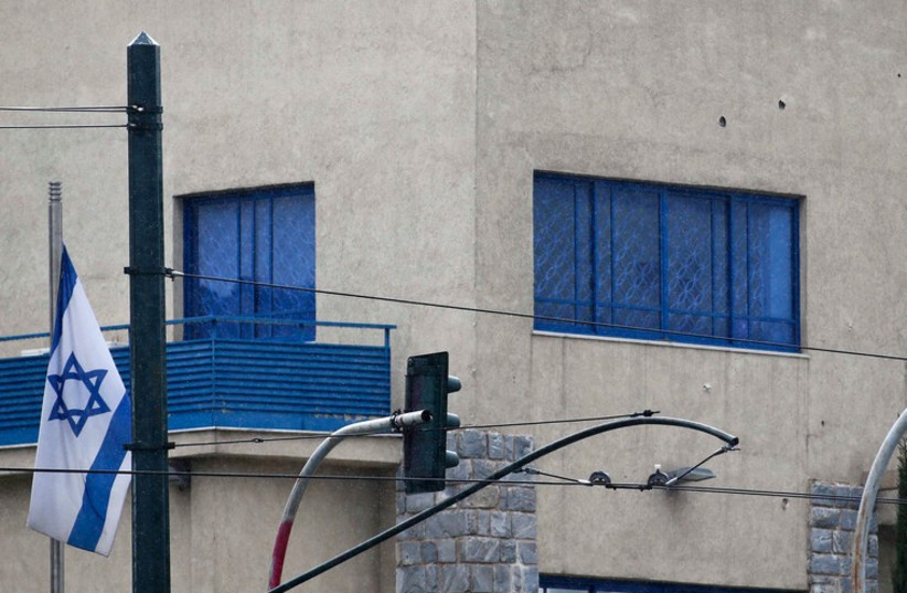 Bullets holes are seen of the wall of the Israeli embassy in Athens December 12, 201 (photo credit: REUTERS)