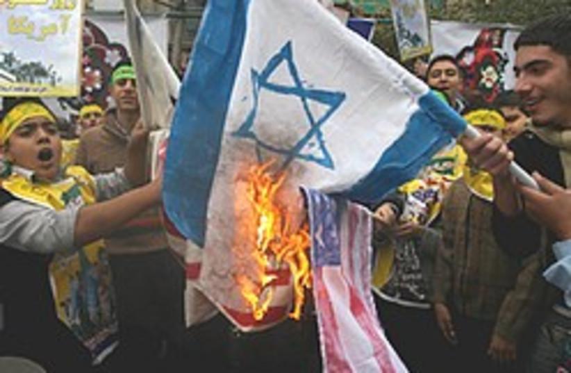 iran flag burning 248.88 (photo credit: AP)