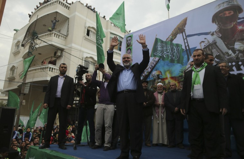 Gazans celebrate the 27th anniversary of Hamas' founding, Debmer 14, 2014 (photo credit: REUTERS)