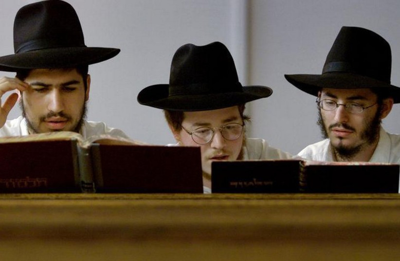 Yeshiva students pray in a synagogue in the Sydney suburb of Bondi (photo credit: REUTERS)