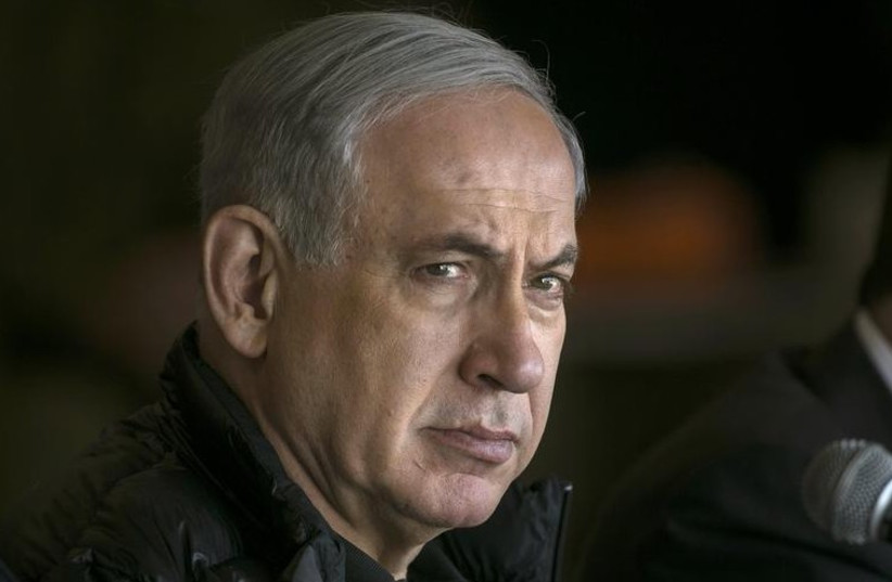 Prime Minister Benjamin Netanyahu watches IDF maneuvers from an army base near Beersheba (photo credit: REUTERS)