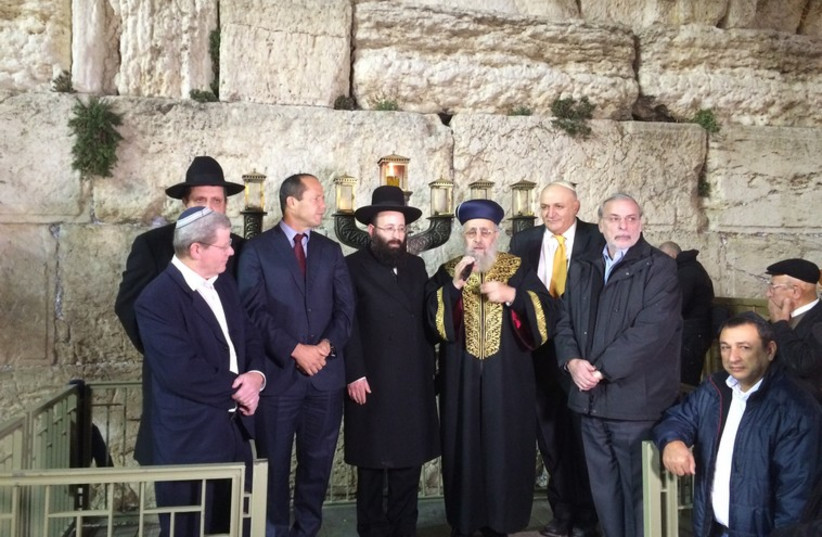 Mayor of Jerusalem Nir Barkat and Chief Rabbi Yitzhak Yosef brought in the Hanukka holiday Tuesday evening at a ceremony by the Western Wall (photo credit: WESTERN WALL HERITAGE FOUNDATION)
