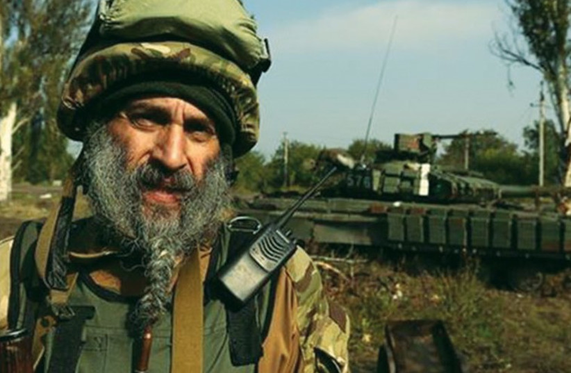 HASSIDIC SOLDIER Asher Joseph Cherkassky stands near a tank in eastern Ukraine. (photo credit: FACEBOOK)
