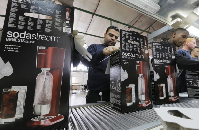 Employees at a SodaStream factory (photo credit: REUTERS)