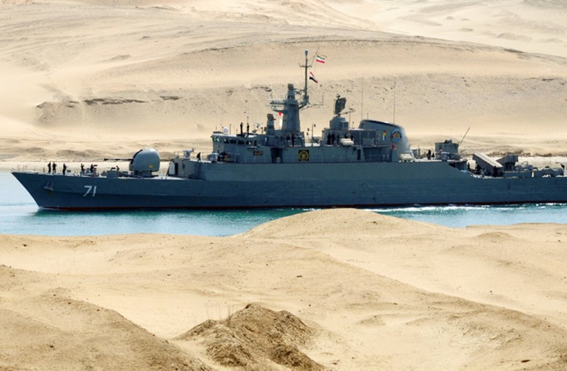 An Iranian naval ship travels through the Suez Canal (photo credit: REUTERS)