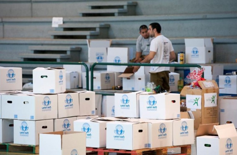 Boxes of food for the poor (photo credit: LATET)