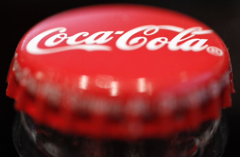A logo is seen on a Coca-Cola bottle  (photo credit: REUTERS)