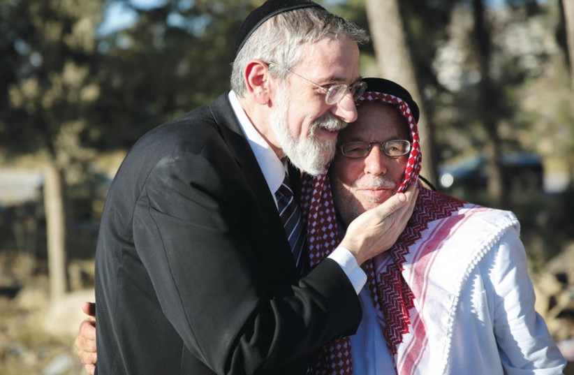 A rabbi and a sheikh at a prayer session for Muslims and Jews in Gush Etzion. (photo credit: ELIAZ COHEN)