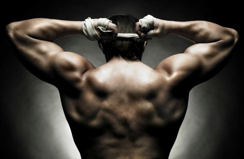 Athlete with big muscles (illustrative) (photo credit: INGIMAGE)