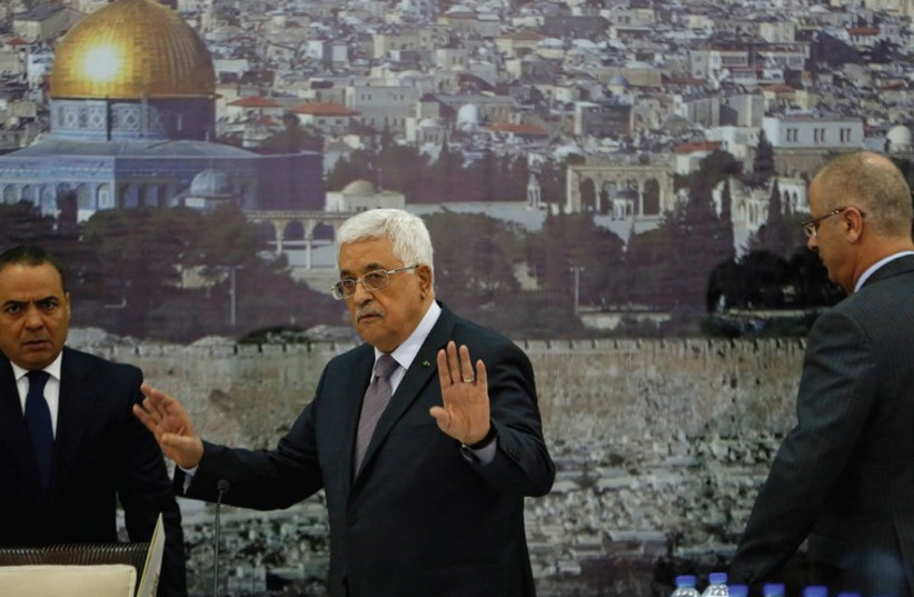 Palestinian Authority President Mahmoud Abbas gestures during a meeting in Ramallah (photo credit: REUTERS)