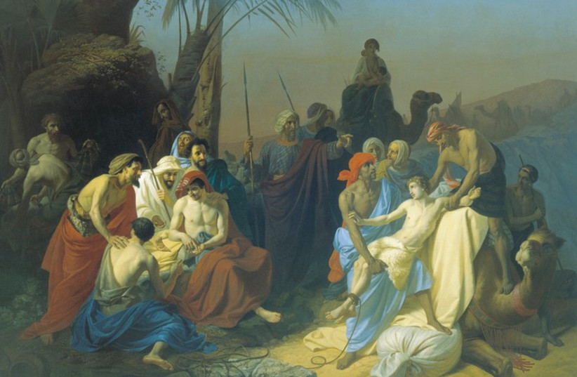 Joseph's brothers sell him into captivity, in an 1855 painting by Konstantin Flavitsky. (photo credit: Wikimedia Commons)