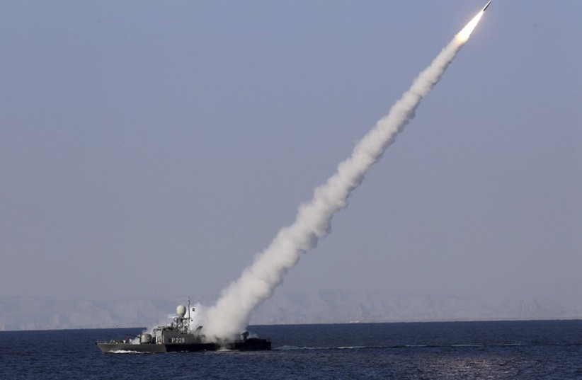 Missile fired from warship during Iranian naval drill [file] (photo credit: REUTERS)