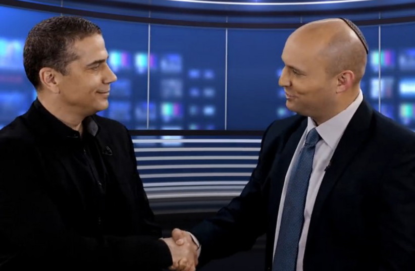 Bayit Yehudi leader Naftali Bennett (R) welcomes veteran television news anchor Yinon Magal (photo credit: FACEBOOK)