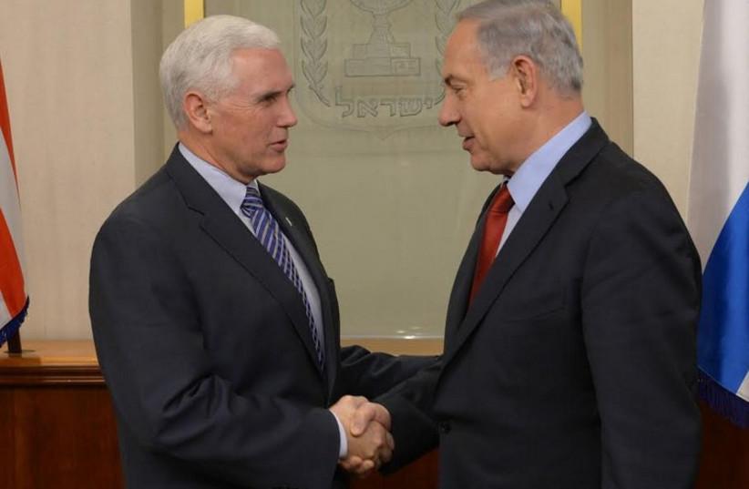 Prime Minister Benjamin Netanyahu meets with Mike Pence, December 29, 2014 (photo credit: AMOS BEN GERSHOM, GPO)