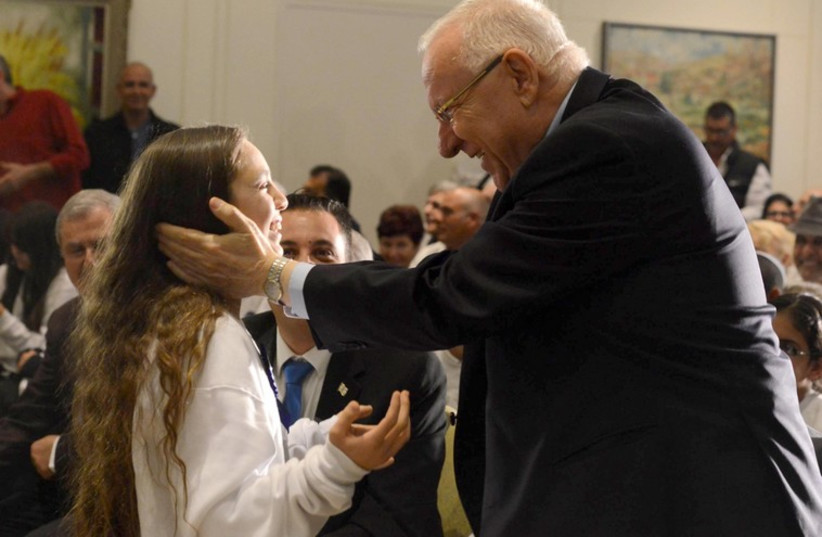 Pres. Rivlin  at the 13th annual Bar/Bat Mitzvah ceremony at the President's Residence for boys and girls who were either injured themselves or who lost a parent or whose parents were permanently injured in a terrorist incident. (photo credit: Courtesy)