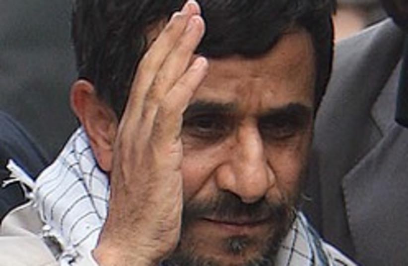 ahmadinejad salutes 248.88 (photo credit: AP)