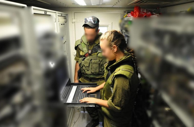 Soldiers from the IDF C4i Branch operating equipment (photo credit: IDF SPOKESMAN'S UNIT)