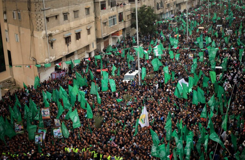 Palestinians Hamas supporters take part in a rally ahead of the 27th anniversary of the movement founding, in Jabaliya in the northern Gaza Strip (photo credit: REUTERS)