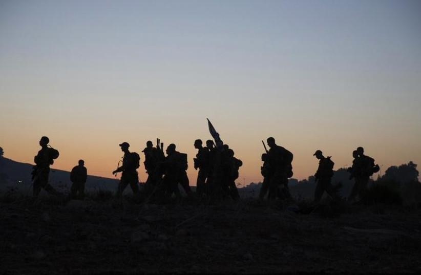 IDF combat soldiers complete a long march as part of their advanced training (photo credit: REUTERS)