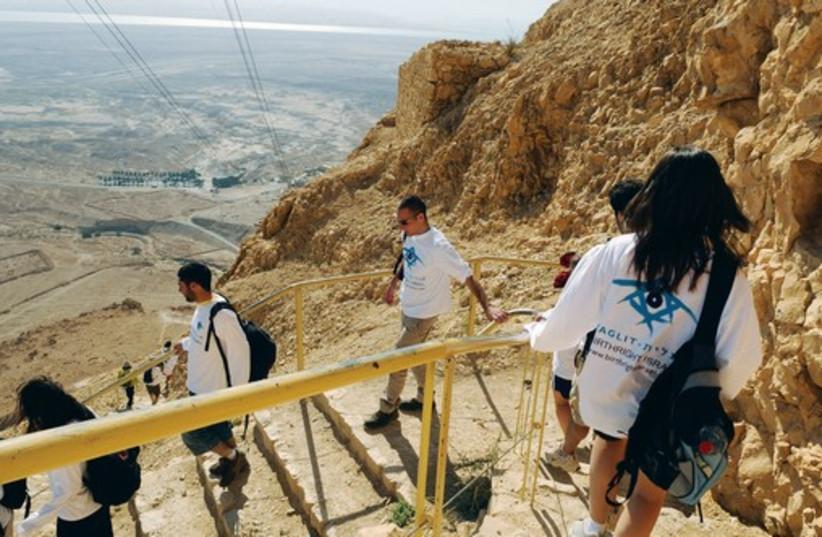 A TAGLIT-BIRTHRIGHT group climbs down the slope of Masada (photo credit: TAGLIT-BIRTHRIGHT)