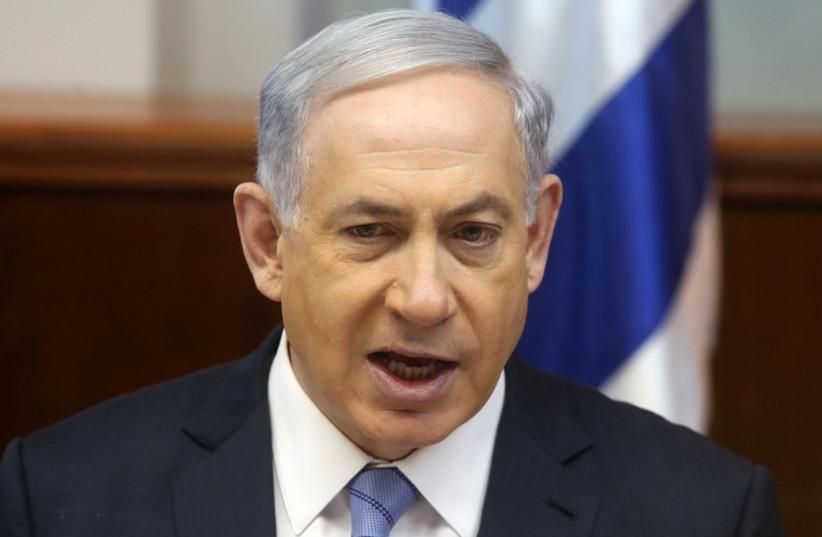 Netanyahu at cabinet meeting (photo credit: MARC ISRAEL SELLEM/THE JERUSALEM POST)