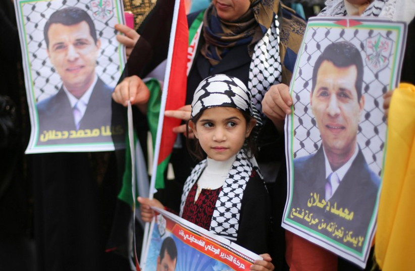 Palestinians hold posters of Mohammed Dahlan during a Gaza rally, December 18, 2014 (photo credit: REUTERS)