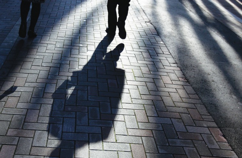 UNETHICAL PRACTICES cast a shadow, much like the one in this photo, over one's professional life. (photo credit: REUTERS)