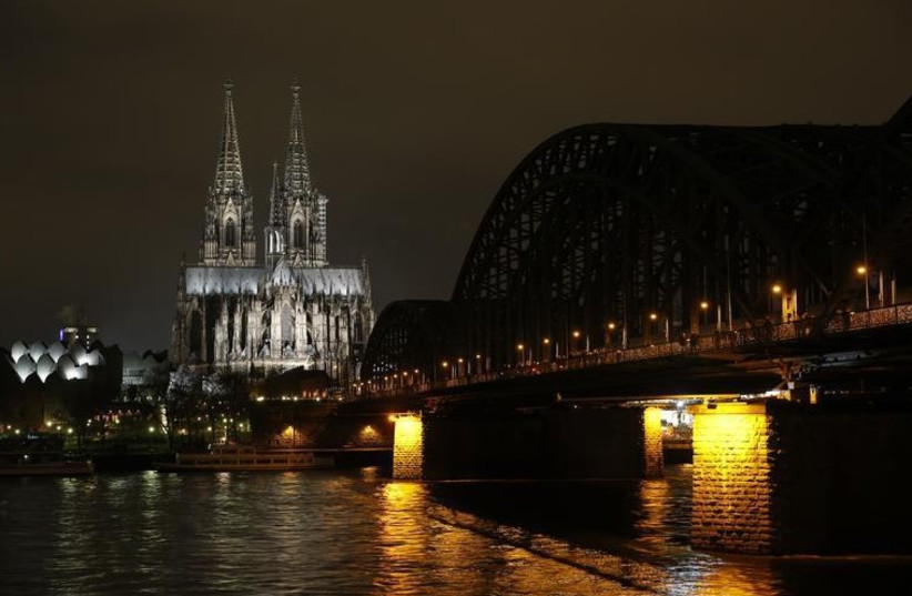 Picture shows the famous Cologne Cathedral before its illumination is switched off in a protest against a march by the growing grass-roots anti-Muslim movement through the western German city of Cologne (photo credit: REUTERS)