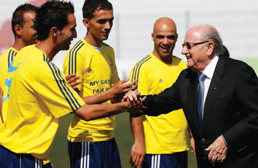 FIFA President Sepp Blatter with Palestinian soccer coaches (photo credit: REUTERS)