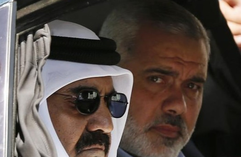 Hamas official Ismail Haniyeh (R) and the Emir of Qatar Sheikh Hamad bin Khalifa al-Thani arrive at a cornerstone laying ceremony in the southern Gaza Strip (photo credit: REUTERS)