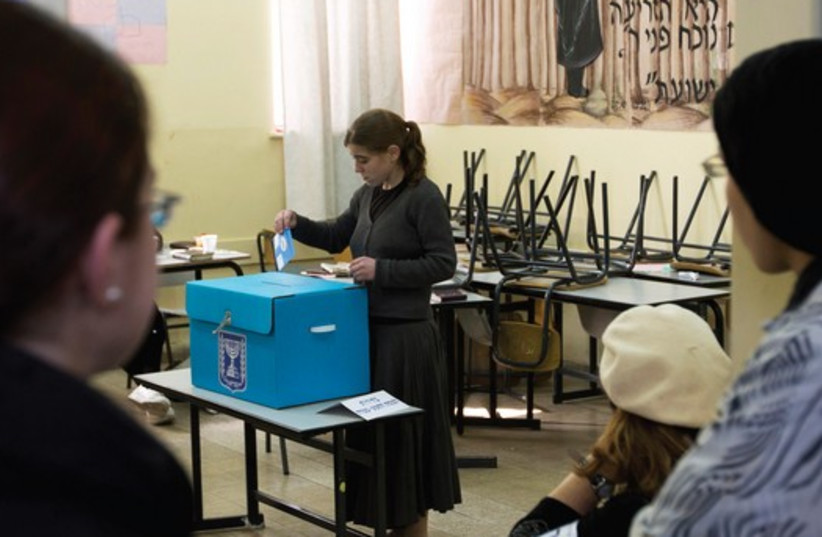 Haredi women vote in the 2013 elections. (photo credit: REUTERS)
