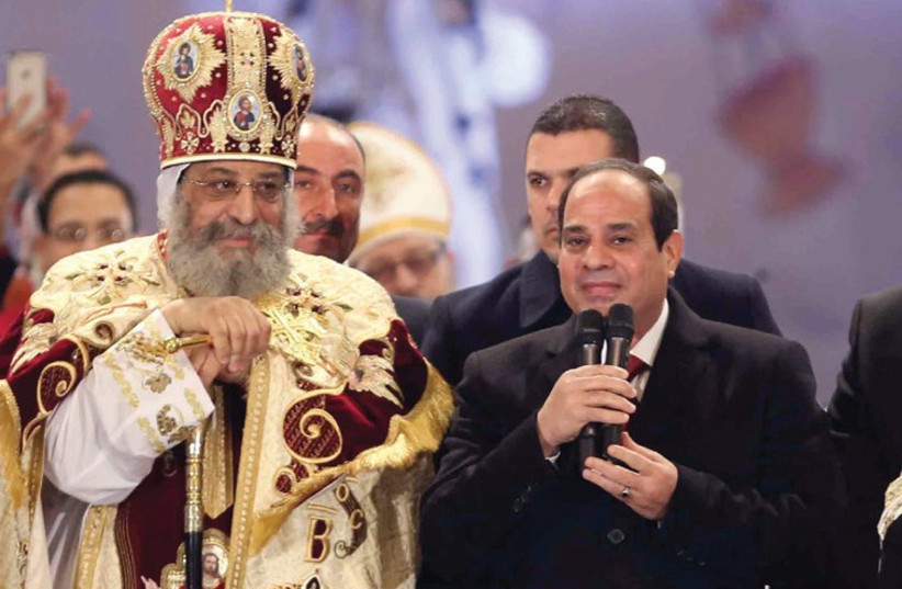 EGYPTIAN PRESIDENT Abdel Fattah al-Sisi speaks next to Coptic Pope Tawadros II (photo credit: REUTERS)