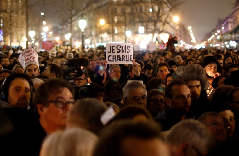 Paris vigil for victims of the shooting that left 12 dead at office of a satirical magazine (photo credit: REUTERS)