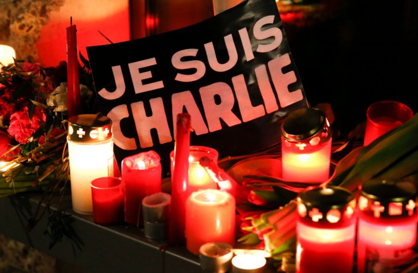 Candelight vigil in tribute to the victims of the shooting at the office of Charlie Hebdo (photo credit: REUTERS)