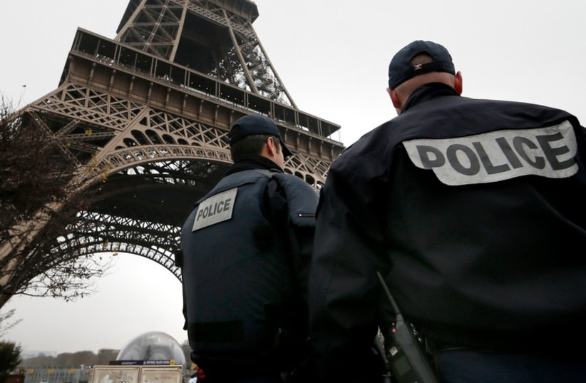 French police patrol near the Eiffel Tower as security in Paris is bolstered after a shooting killed 12 (photo credit: REUTERS)