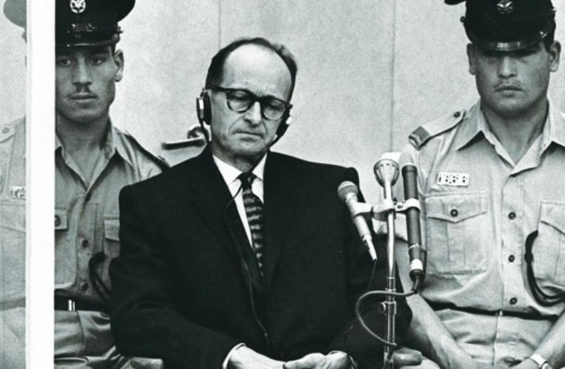 Adolf Eichmann sits during his trial in Jerusalem, 1961. (photo credit: REUTERS)