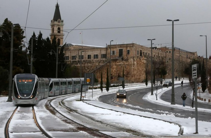 Jerusalem Light Rail in snow (photo credit: MARC ISRAEL SELLEM/THE JERUSALEM POST)
